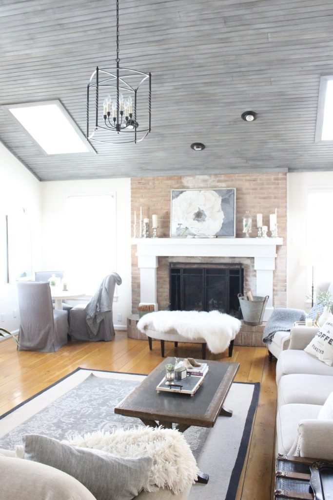 Gray and White Cottage Living Space- farmhouse style room- decor- DIY- weathered wood ceiling treatment- painted ceiling- paint and stain treatment on pine- how to- paint- stain- wood- ceiling- winter decor- room design- home decor- living room decorating ideas- rustic home decor- wall decorating ideas- decoration ideas- room decor ideas- mantel ideas- french county style decor-tv room