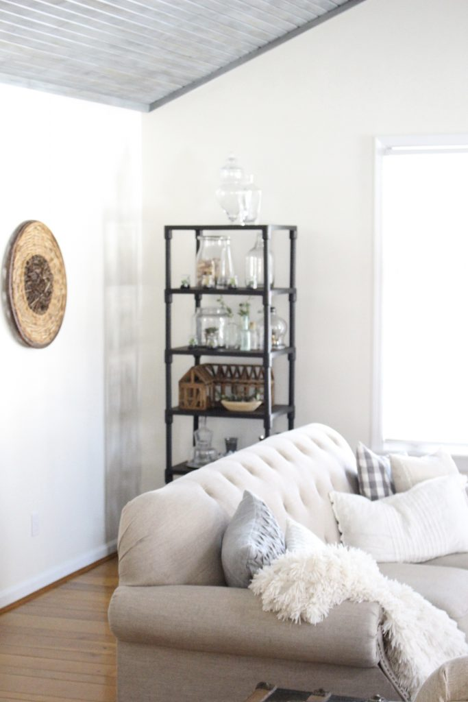 Gray and White Cottage Living Space- farmhouse style room- decor- DIY- weathered wood ceiling treatment- painted ceiling- paint and stain treatment on pine- how to- paint- stain- wood- ceiling- winter decor- room design- home decor- living room decorating ideas- rustic home decor- wall decorating ideas- decoration ideas- room decor ideas- mantel ideas- french county style decor-tv room- vintage glass collection