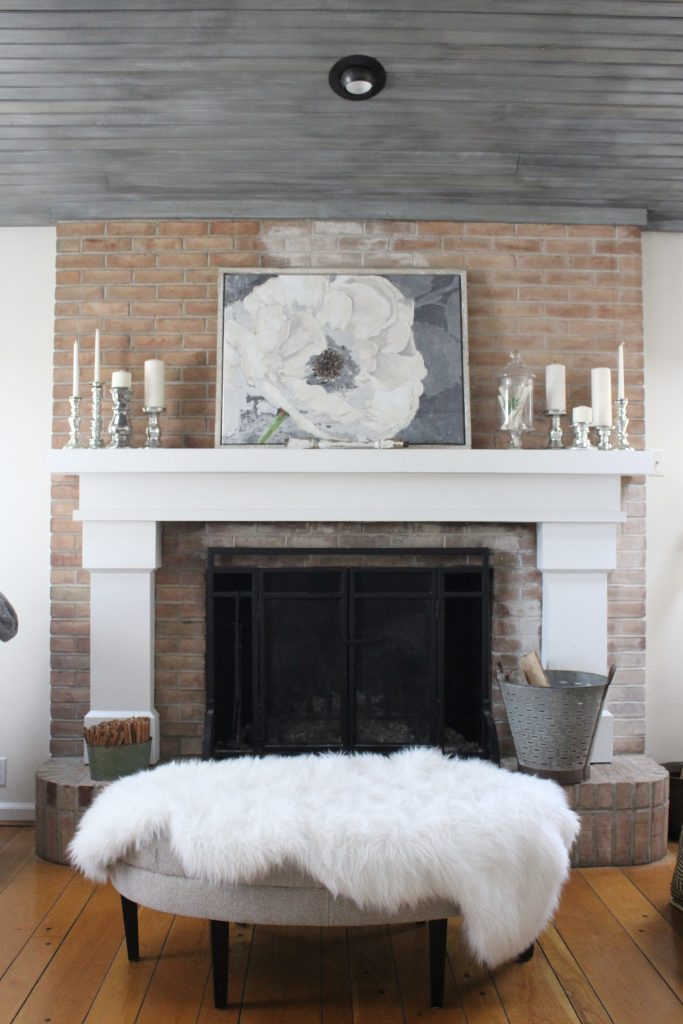 Gray and White Cottage Living Space- farmhouse style room- decor- DIY- weathered wood ceiling treatment- painted ceiling- paint and stain treatment on pine- how to- paint- stain- wood- ceiling- winter decor- room design- home decor- living room decorating ideas- rustic home decor- wall decorating ideas- decoration ideas- room decor ideas- mantel ideas- french county style decor-tv room- winter decor