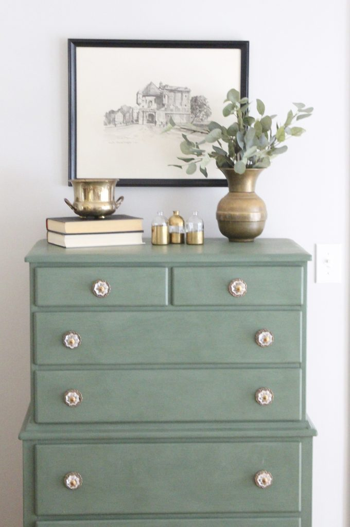 A wood dresser painted green- Amy Howard paints- One step paint- green- Cherbourg- how to use chalk paint- chalk painted finish- green furniture- how to paint furniture- home design- DIY- Do it Yourself project- painted furniture- crystal knobs