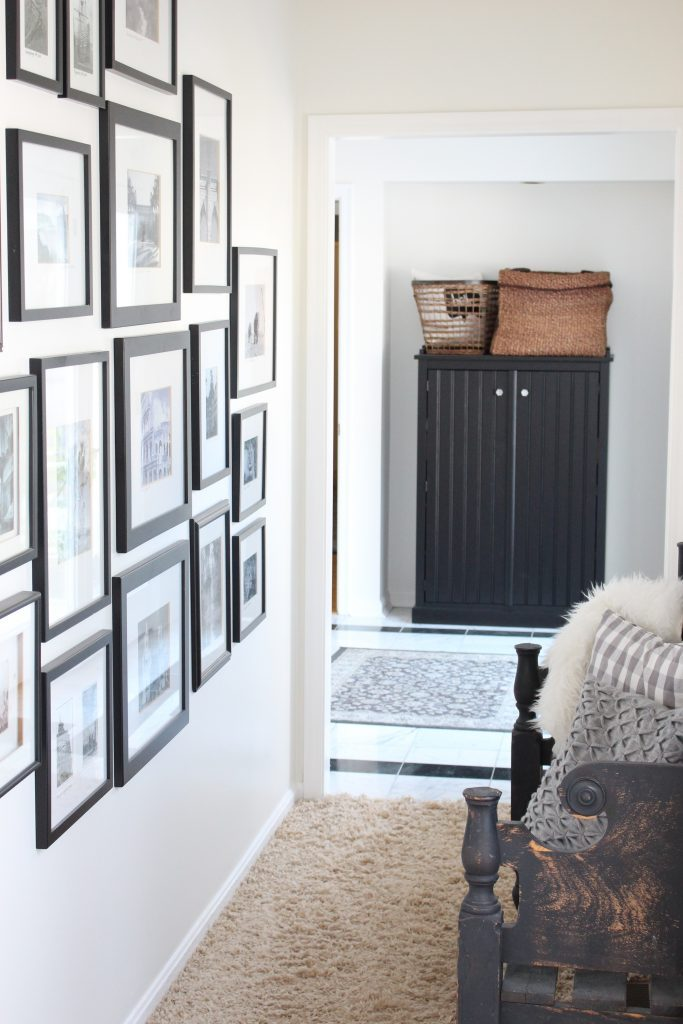 travel gallery- wall gallery- travel photos- how to display- hallway decorating- long hallway- decor- wall decor- black and white photographs- master suite- hallway decor