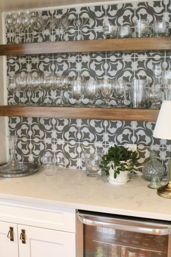 beverage center- bar nook- DIY- bar area- kitchen- pattern tile on the wall- cottage renovation- kitchen renovation- cottage kitchen- farmhouse style kitchen- room decor ideas- DIY projects- floating wood shelve- how to decorate a beverage and bar area