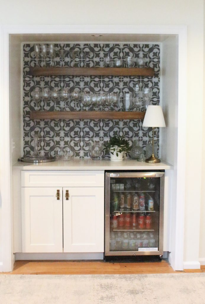 beverage center- bar nook- DIY- bar area- kitchen- pattern tile on the wall- cottage renovation- kitchen renovation- cottage kitchen- farmhouse style kitchen- room decor ideas- DIY projects- floating wood shelves- decorating a bar area