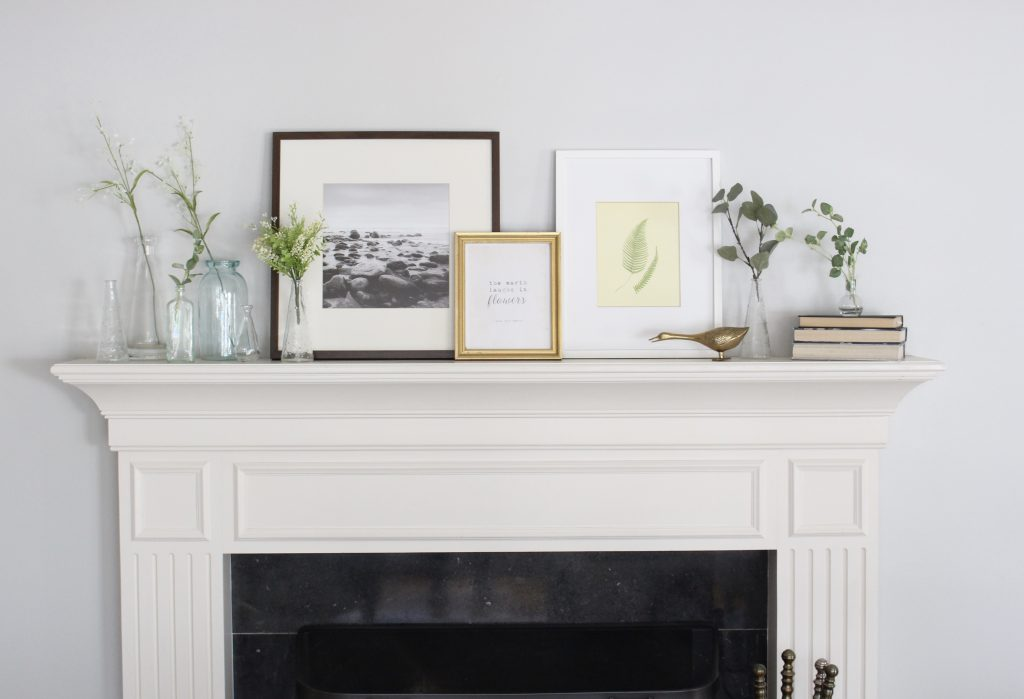 spring mantel decor- how to decorate your mantel for spring- mantles- mantel decorating- spring decor- fresh spring ideas- layered frames- wall decorating ideas- home design- diy- diy projects- seasonal mantel decor