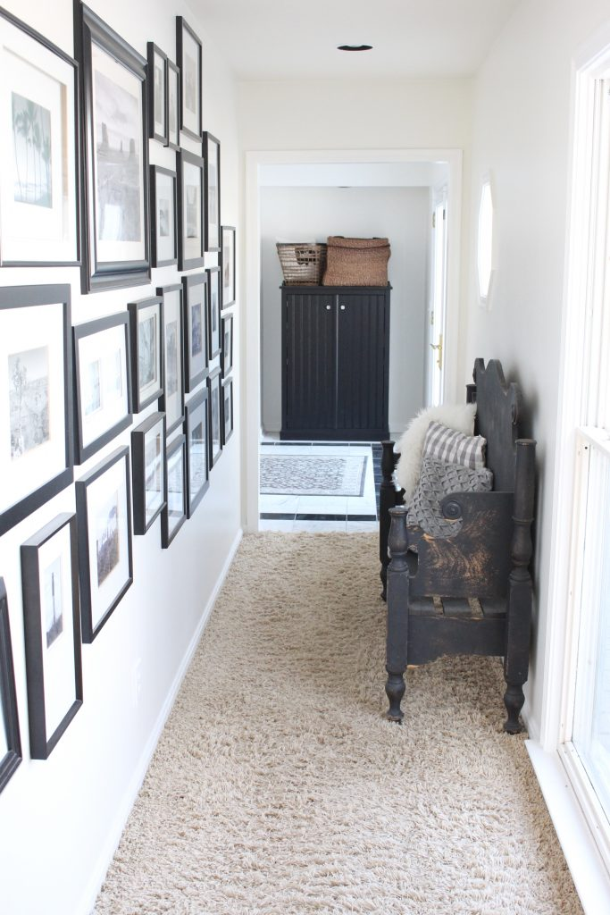 travel gallery- wall gallery- travel photos- how to display- hallway decorating- long hallway- decor- wall decor- black and white photographs- master suite