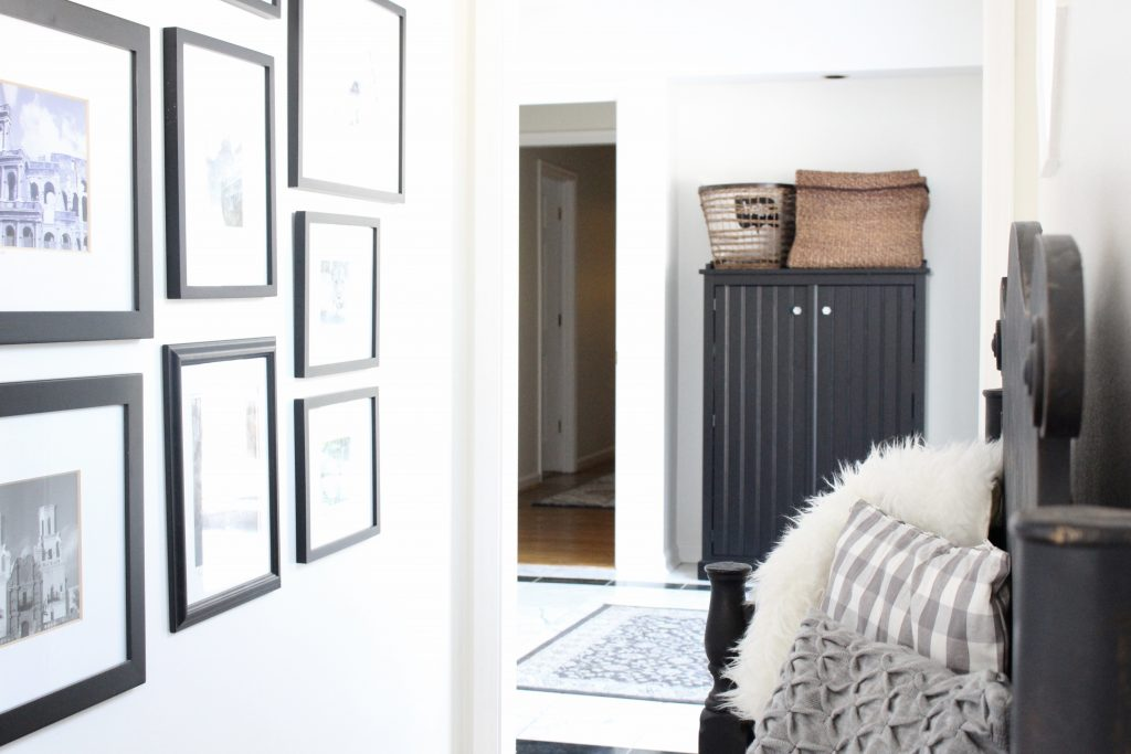 travel gallery- wall gallery- travel photos- how to display- hallway decorating- long hallway- decor- wall decor- black and white photographs- master suite- home decor- wall decorating ideas- DIY gallery wall