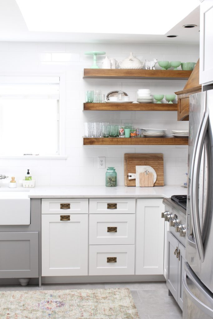 white- cottage- kitchen- renovation- vintage- decor- decorating a white kitchen- farmhouse style- antique brass pulls- hardware- subway tile- floating kitchen shelves