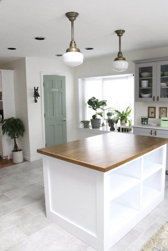 schoolhouse lighting- milk glass lighting- kitchen renovation- pendant lights- vintage- cottage style- farmhouse style- wood and white- antique brass lights- green- painted- pantry door