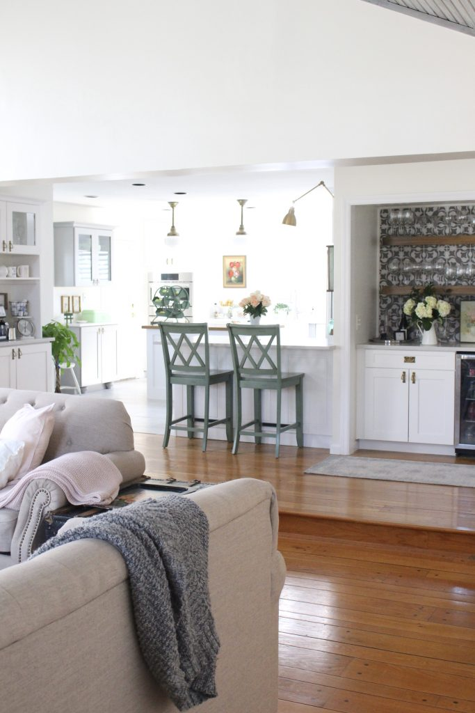 White- Cottage Kitchen- Renovation- Reveal- kitchen design- kitchen decorating ideas- kitchen decor ideas- room design- home decor- design- open shelving- custom island- white cabinets- professional appliances- DIY- Do it Yourself- wood range hood- cottage design- farmhouse kitchen- gray cabinets- Thermador professional range with griddle- peninsula with stools- wine and beverage bar- nook