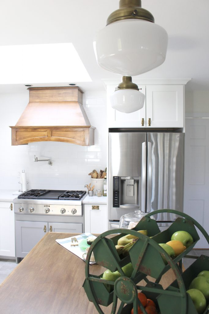 White- Cottage Kitchen- Renovation- Reveal- kitchen design- kitchen decorating ideas- kitchen decor ideas- room design- home decor- design- open shelving- custom island- white cabinets- professional appliances- DIY- Do it Yourself- wood range hood- cottage design- farmhouse kitchen- gray cabinets- Thermador professional range with griddle- antique brass schoolhouse lighting