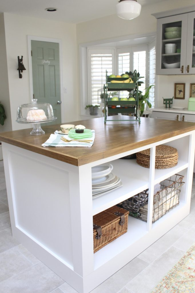 White- Cottage Kitchen- Renovation- Reveal- kitchen design- kitchen decorating ideas- kitchen decor ideas- room design- home decor- design- open shelving- custom island- white cabinets- professional appliances- DIY- Do it Yourself- wood range hood- cottage design- farmhouse kitchen- gray cabinets- how to style an island