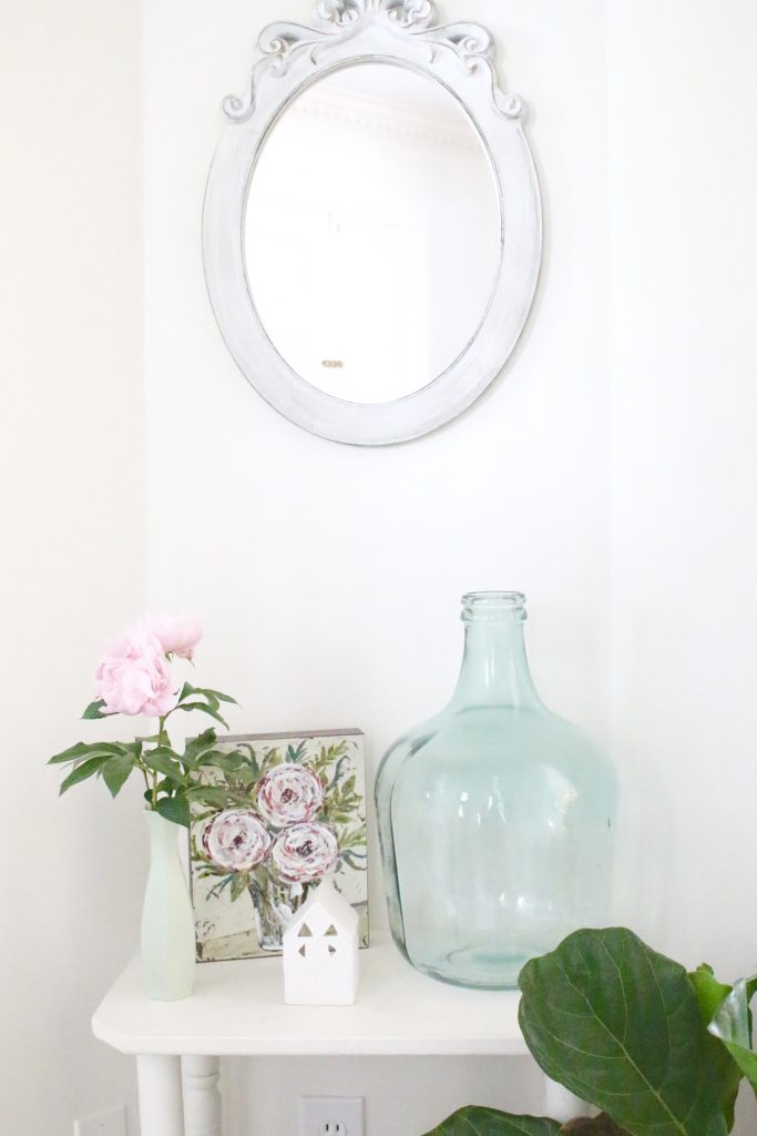 peony- flowers- gardening- vignette- how to - decorate- an entryway- entryway ideas- home decor- using flowers in decorating- faux milk glass- fiddle fig leaf- demijohn bottles- flower artwork- home design- painted furniture- foyer