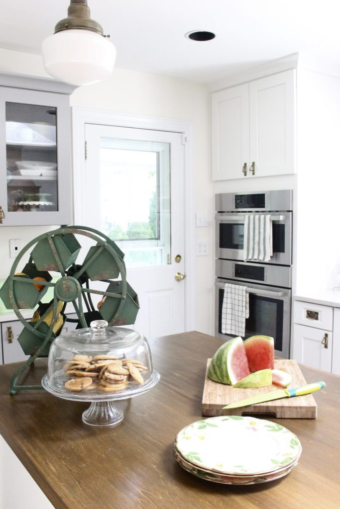 White Cottage Kitchen Renovation Reveal- kitchen renovation- remodel-kitchen reveal- cottage kitchen- white cabinets- vintage- green- wood countertops- cottage style- kitchen decor- kitchen design- professional appliances- two different color cabinets