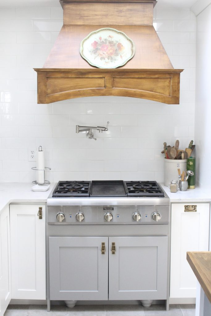 White Cottage Kitchen Renovation Reveal- kitchen renovation- remodel-kitchen reveal- cottage kitchen- white cabinets- wood range hood- vintage- painted- tray
