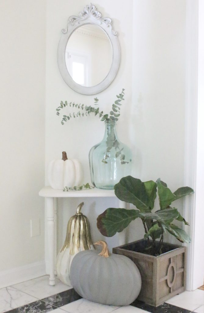 A fall vignette in the entryway- seasonal decor- fall decorating- wooden pumpkins- autumn decor- decorating an entry- home design- fiddle leaf fig