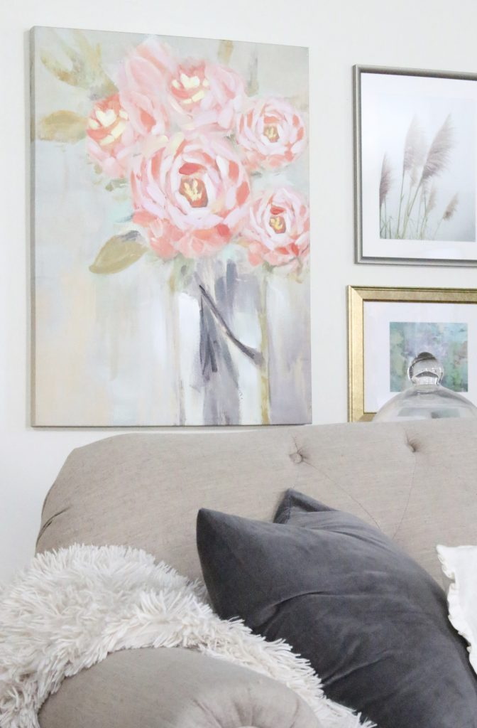 A new gallery wall in our family room- pastels- paintings- gallery wall- arrangement- wall decor- artwork- pale colors- neutrals- updated wall art- Home Goods- vintage- flower- art