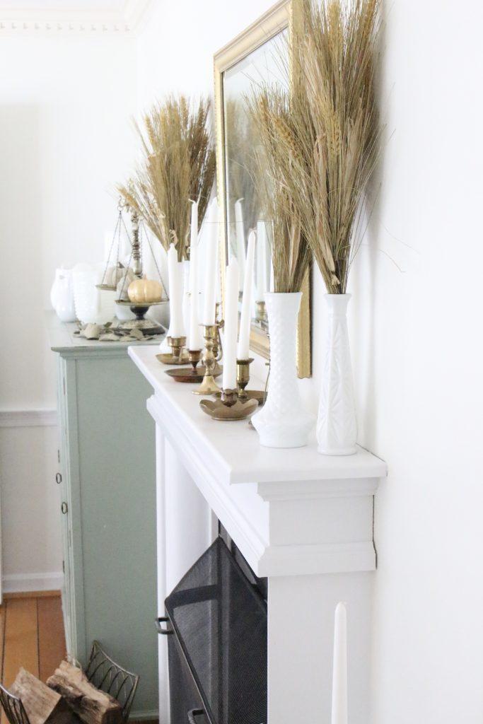 Fall mantel decor- simple- understated- wheat- milk glass- antique brass candlesticks- dining room decor- fall decorating
