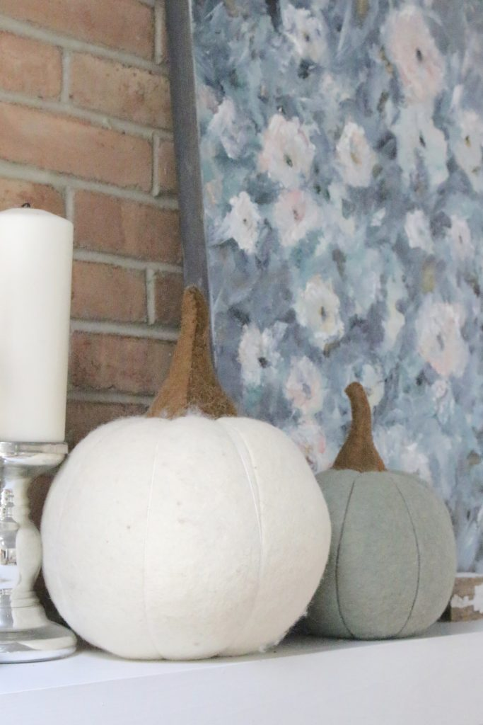 Fall pastels in our family room- pastel colors- neutrals- decorating for fall with pastel- seasonal decor- fall- autumn- living space- room design- wall decor- fall decor- pink- green- gray for autumn- decorating- decor ideas- non traditional colors for fall- white pumpkins