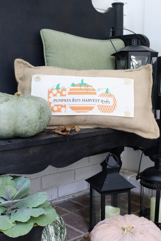 White brick ranch home- fall decor- decorating a small porch for fall- cottage home- outdoor decorating- home design- autumn decor- pumpkins- mums- front porch- handmade wreath- decorating with black and white- seasonal pillow made to use for different holidays- handmade pillow