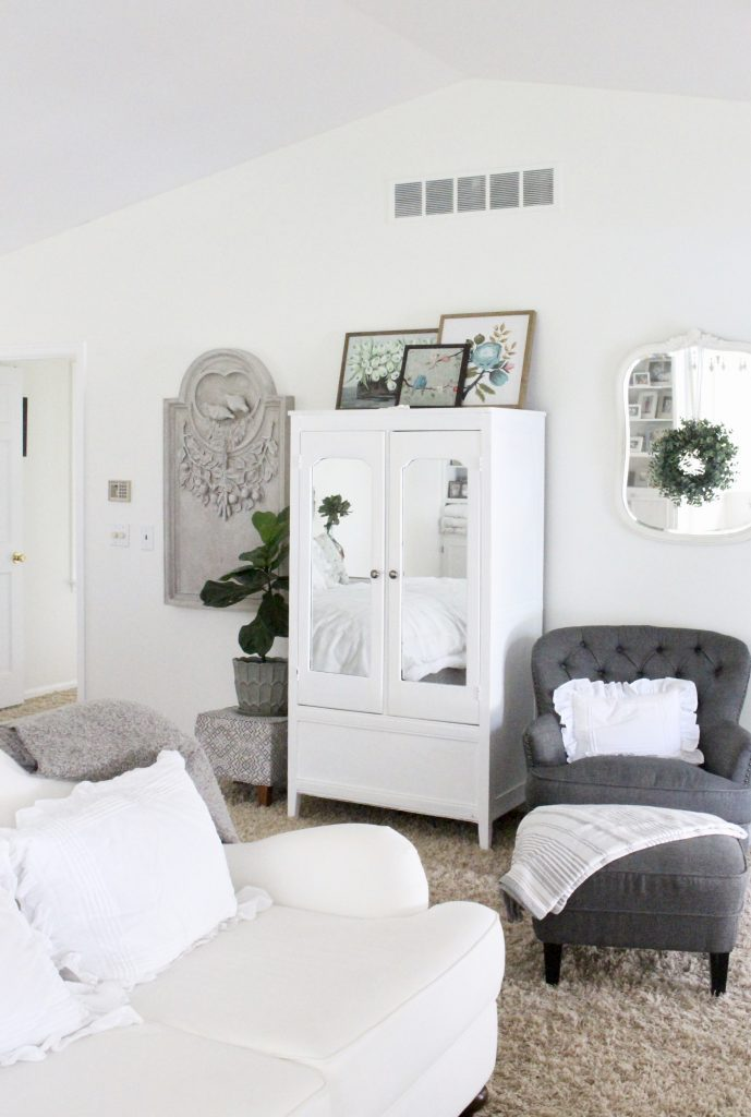 White Cottage Master Bedroom- gray- white- green- shabby chic bedroom- farmhouse decor- layered mirrors- painted gray furniture- DecoArt- Repose Gray- white bedding- white painted furniture- Armoire- fireplace in the bedroom- home design- large bedroom space- sitting area in the bedroom- bookshelves in a bedroom- Ballard Designs art