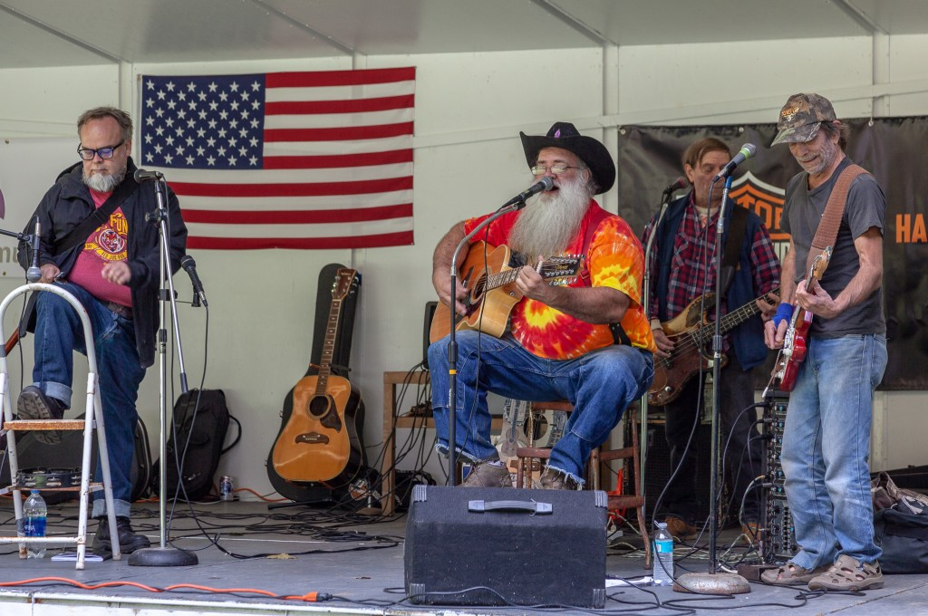 "Photo by Dave Warner - Rope Smokin' Roy ""The Hair Farmer"" and his Orphans of the Storm perform at the 2018 Bluegrass, Bikes & BBQ Festival at Moreland Park."