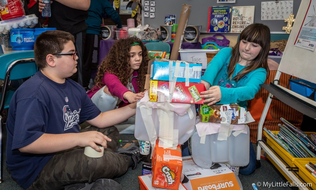 Photo by Dave Warner - Students in Tracy Young's fifth grade STEM class work on a 'dog washer' project.