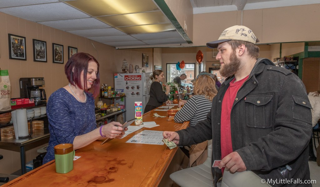Photo by Dave Warner - Laura Powers takes an order from a customer on her iPad.
