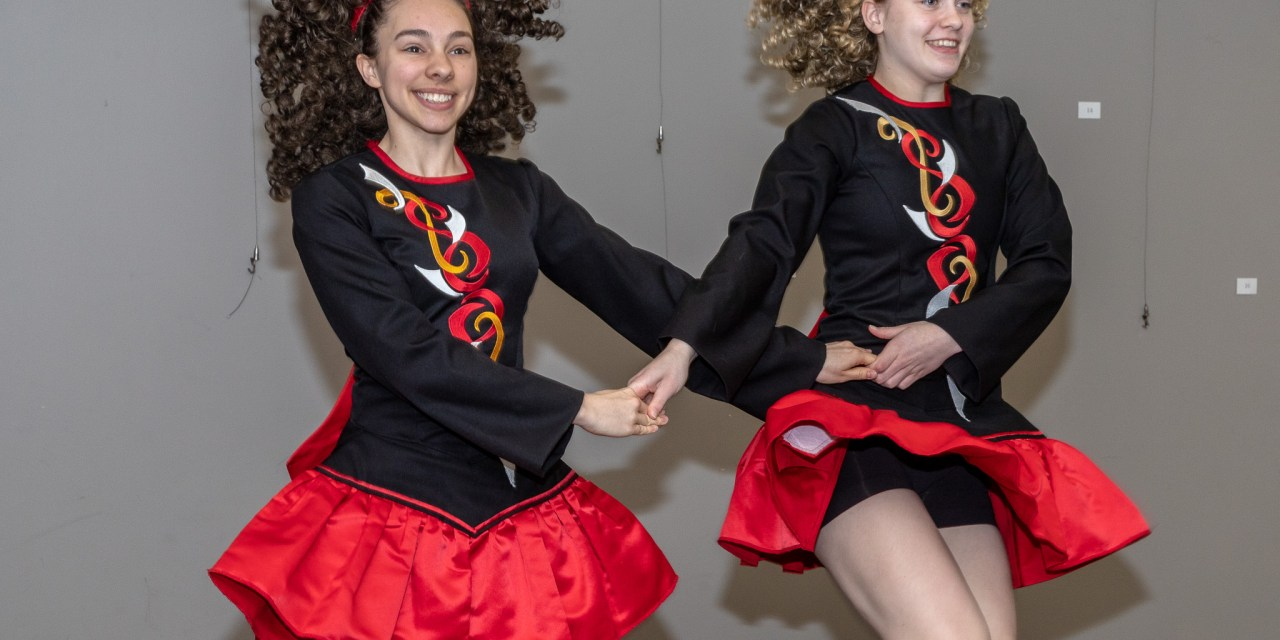 Irish dancers entertain a crowd at the library