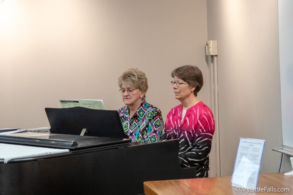 Photo by Dave Warner - Helen Maksymiczand Martha Regelmann perform a duet at the Little Falls Library.
