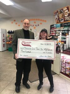 Photo submitted - David Dardzinski, President of Preserve Our Past (POP) accepts a check from Stewarts for $500 to help restore the bandstand in Burke Park.