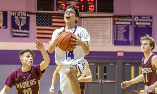Raiders control Mounties in 61-31 loss