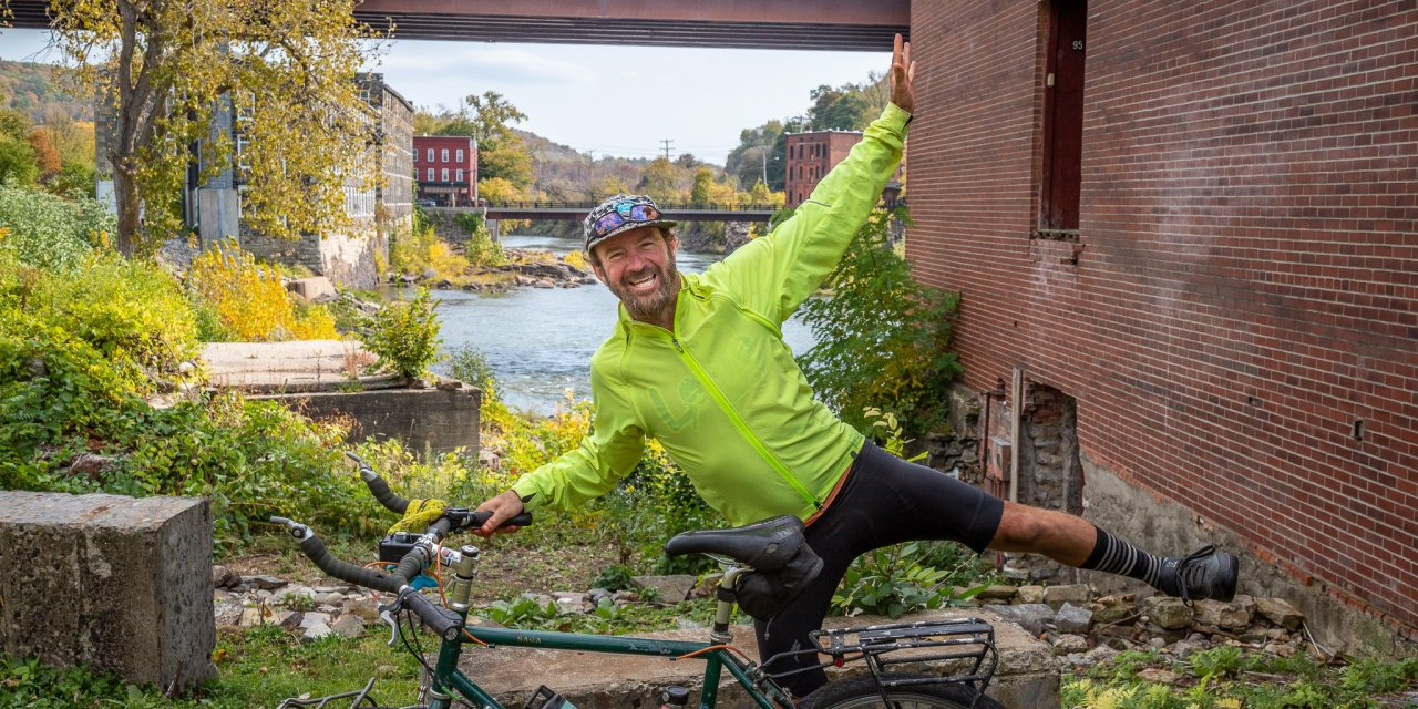 Cyclist rides through Little Falls on way around the country