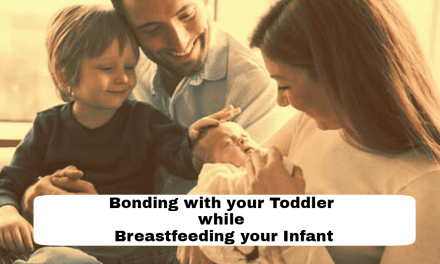 Breastfeeding baby while bonding with your toddler