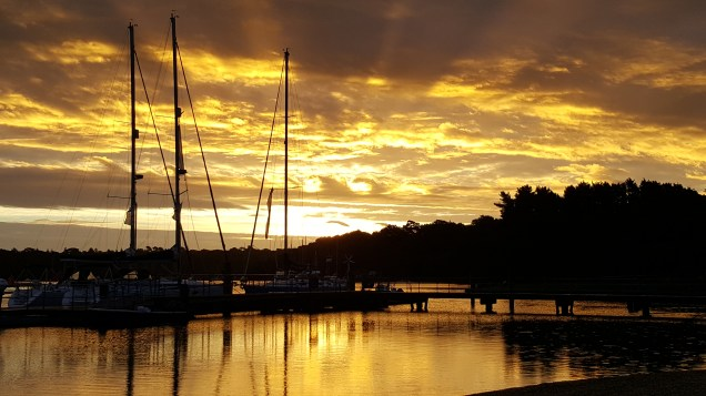 Sunrise on Beaulieu River with our boats in the front.