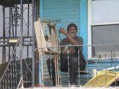 Man repairs fan.