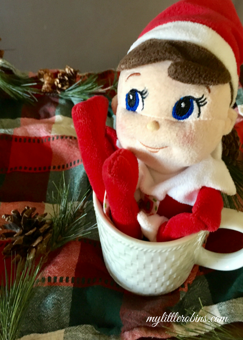 Elf in the coffee mug- perfect to encourage us to gift a Starbucks gift card!