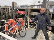 Ferry man helps me with my bike