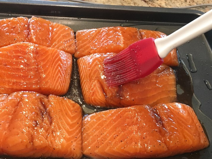 Remove fish from bowl and place on a non-stick baking sheet. Brush on any leftover marinade.