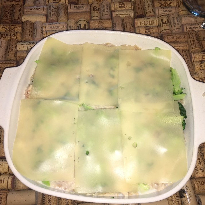 In a small bowl mix together mushroom soup and 1 can of milk. Pour the mixture over top of broccoli. Next, cover the entire casserole with Swiss cheese.