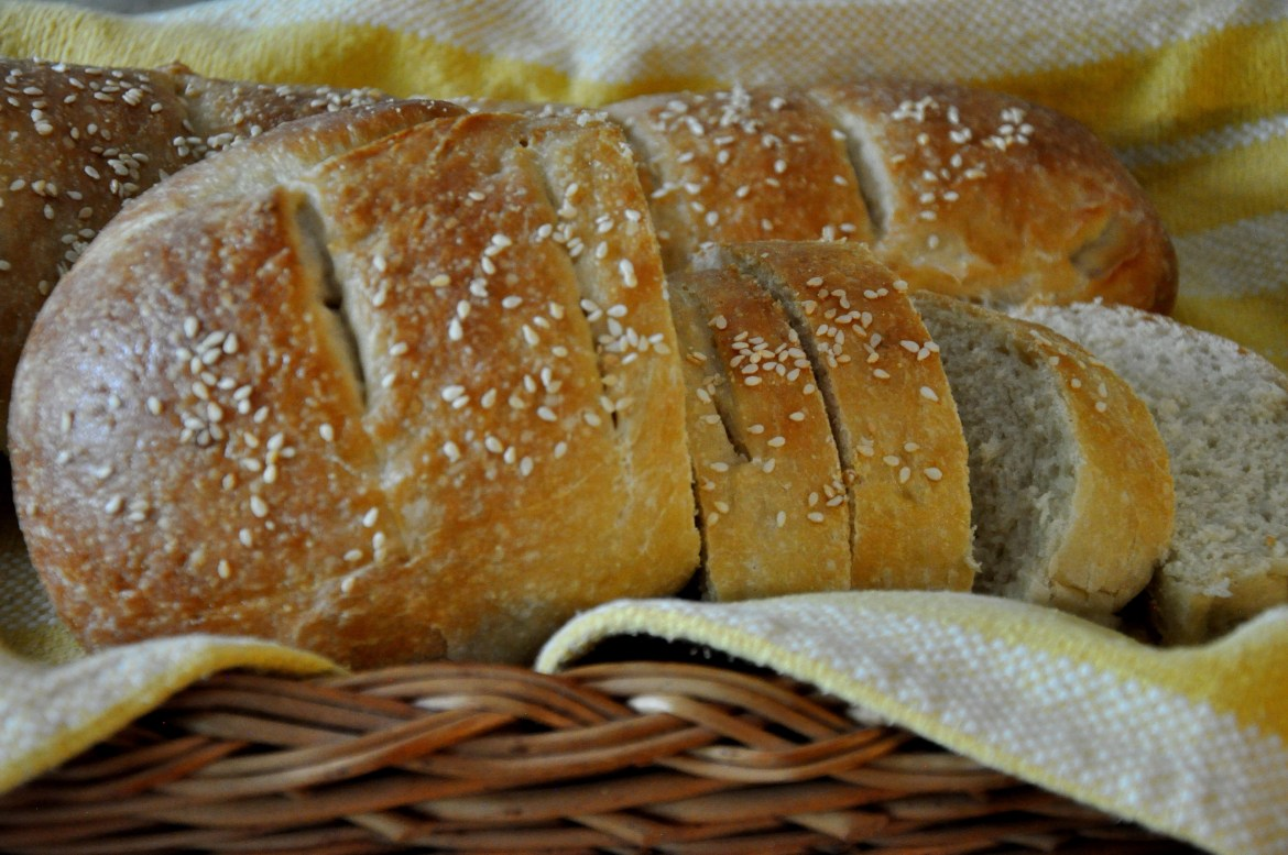 Crusty Italian Bread in basket sprinkled with sesame seeds