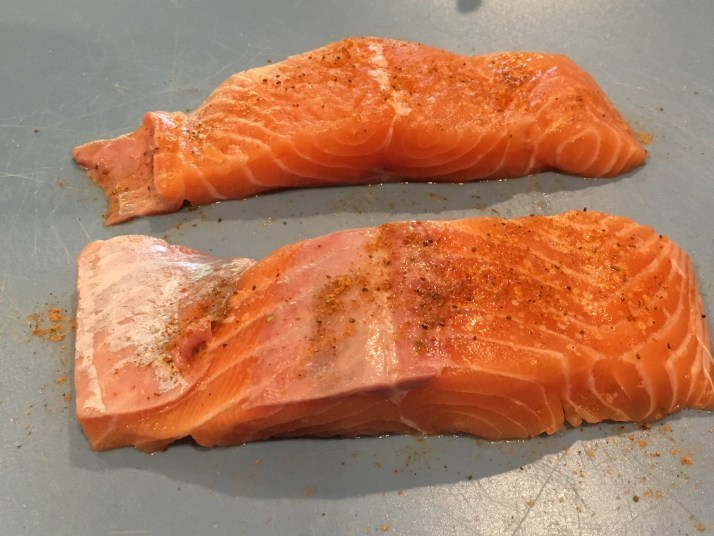 Rinse salmon portions and pat dry with paper towel. Season both sides of each portion with seafood seasoning.