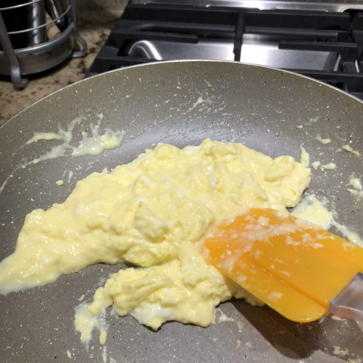 Using a rubber spatula continue to turn eggs until they are a soft set texture.