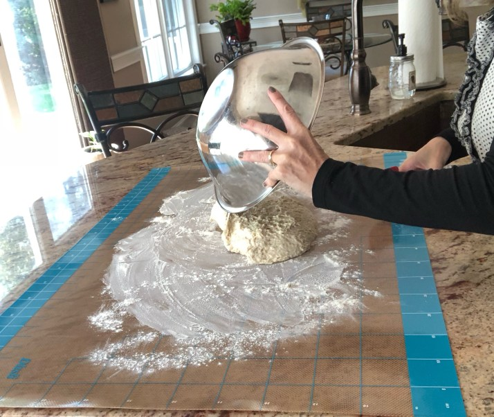 Pour dough onto a floured surface using a rubber spatula.