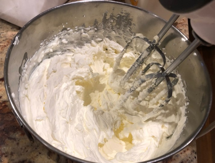 In a separate bowl blend remainder of whipping cream with the powdered sugar until light and fluffy.