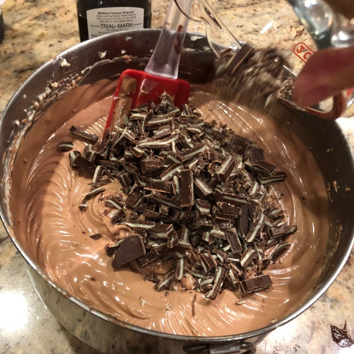 chopped Andes Candies in batter