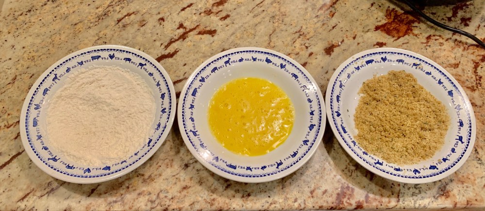 cut fish into four pieces in a shallow bowl mix flour and seafood seasoning  in another shallow bowl beat 1 egg in a third shallow bowl place breadcrumbs and melted butter and mix well. taking one piece of fish at a time, start by dredging the fish filet through the flour until it is well coated