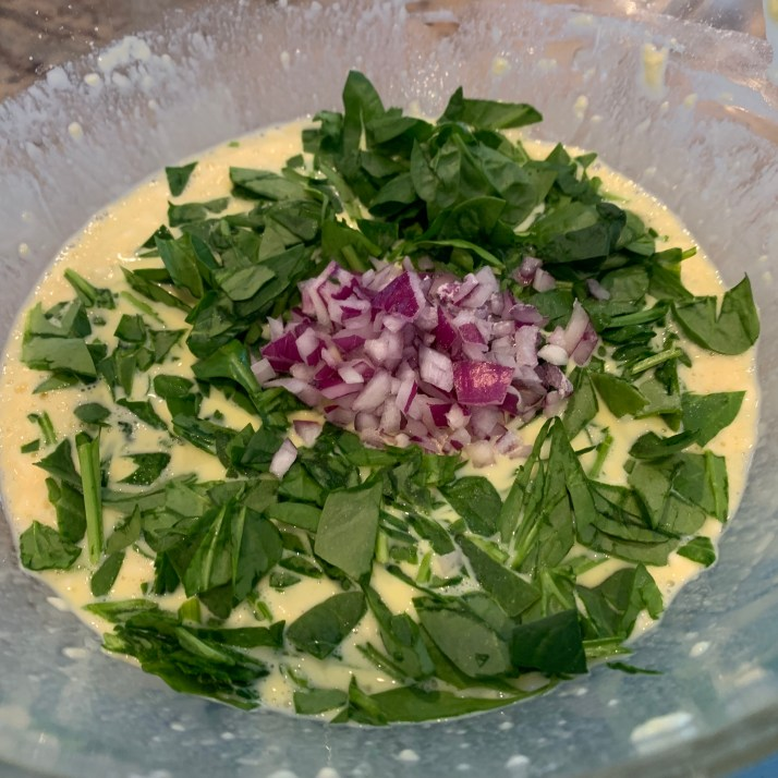 add minced onion, chopped spinach and salt and pepper and stir.