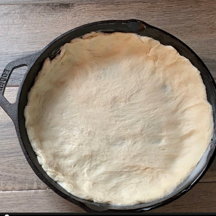 <!-- wp:list --> <ul><li>split the pizza dough in two and spread ½ of the dough so that you have about 2 inches around the sides of the pan</li></ul> <!-- /wp:list -->  <!-- wp:paragraph --> <p>*you may find it easier to roll out the dough first, but it isn't necessary</p> <!-- /wp:paragraph -->