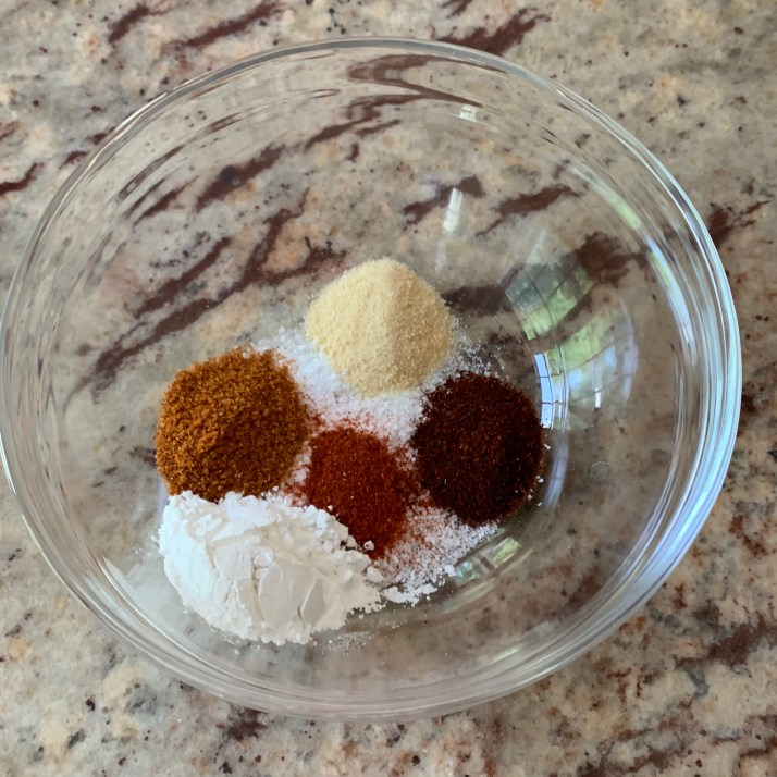 place all the spices together in a small bowl with the cornstarch and baking soda and whisk them together