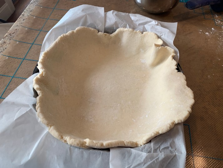 carefully place the dough into a skillet lined with parchment paper